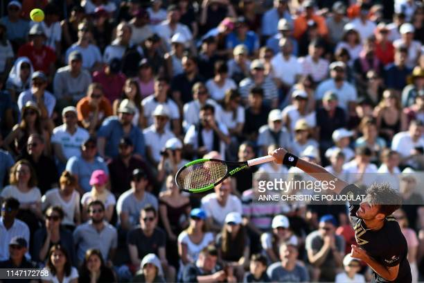 Argentina's Juan Ignacio Londero serves the ball to France's Corentin Moutet during their men's singles third round match on day six of The Roland...
