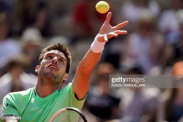 Argentina's Juan Ignacio Londero serves the ball to France's Nicolas Mahut during their men's singles third round match on day six of The Roland...