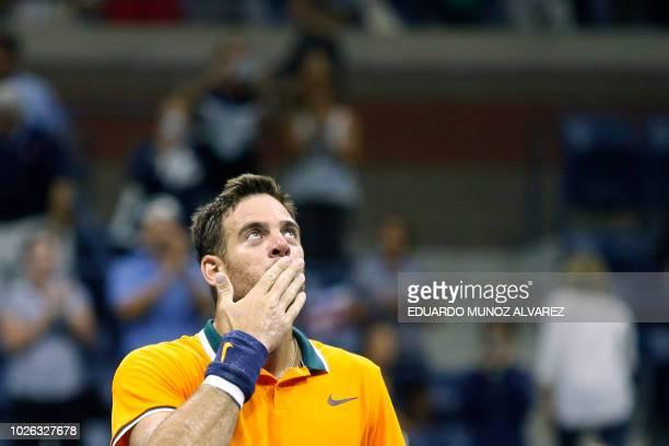 Argentina's Juan Martin del Potro blows a kiss as he celebrates after defeating Croatia's Borna Coric during their men's singles tennis match Day 7...