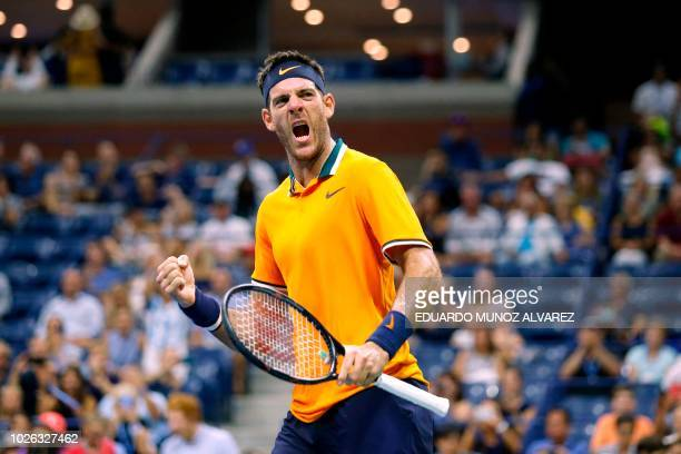 TOPSHOT Argentina's Juan Martin del Potro celebrates after defeating Croatia's Borna Coric during their men's singles tennis match Day 7 of the 2018...