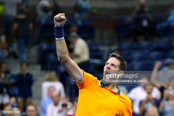 Argentina's Juan Martin del Potro celebrates after defeating Croatia's Borna Coric during their men's singles tennis match Day 7 of the 2018 US Open...