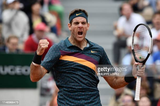 TOPSHOT Argentina's Juan Martin del Potro celebrates after winning against Japan's Yoshihito Nishioka during their men's singles second round match...