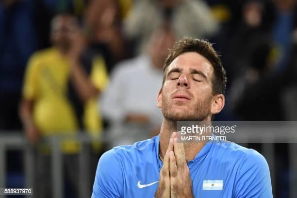 Argentina's Juan Martin Del Potro celebrates after winning his men's singles quarter-finals tennis match against Spain's Roberto Bautista Agut at the...