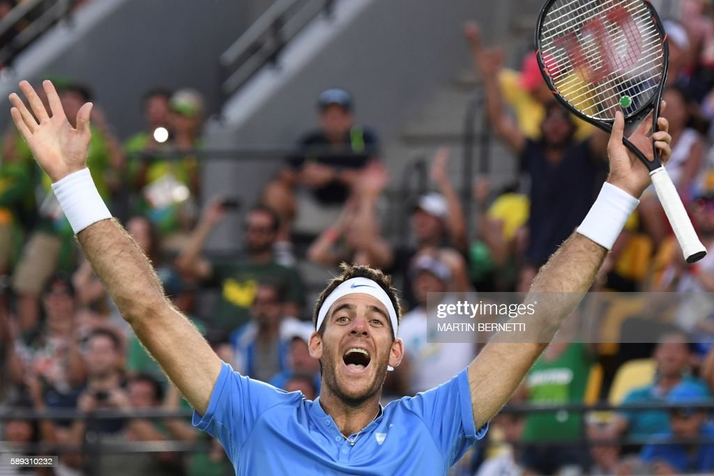 TOPSHOT - Argentina's Juan Martin Del Potro celebrates after winning his men's singles semi-final tennis match against Spain's Rafael Nadal at the Olympic Tennis Centre of the Rio 2016 Olympic Games in Rio de Janeiro on August 13, 2016. / AFP PHOTO / Martin BERNETTI