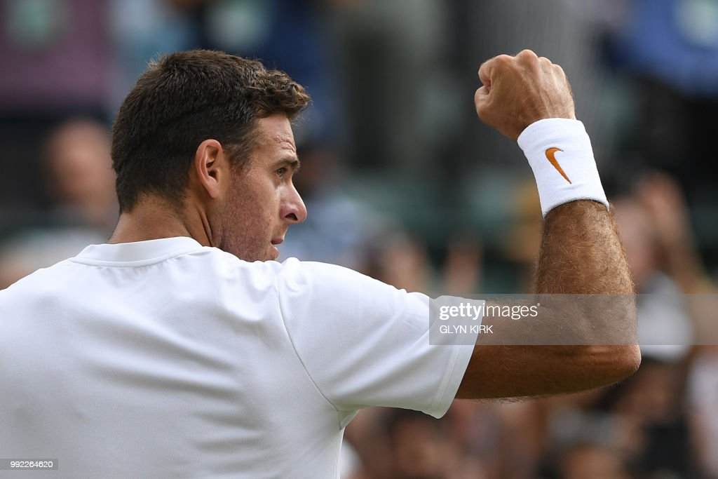TOPSHOT - Argentina's Juan Martin del Potro celebrates winning against Spain's Feliciano Lopez during their men's singles second round match on the fourth day of the 2018 Wimbledon Championships at The All England Lawn Tennis Club in Wimbledon, southwest London, on July 5, 2018. - Del Potro won the match 6-4, 6-1, 6-2. (Photo by Glyn KIRK / AFP) / RESTRICTED