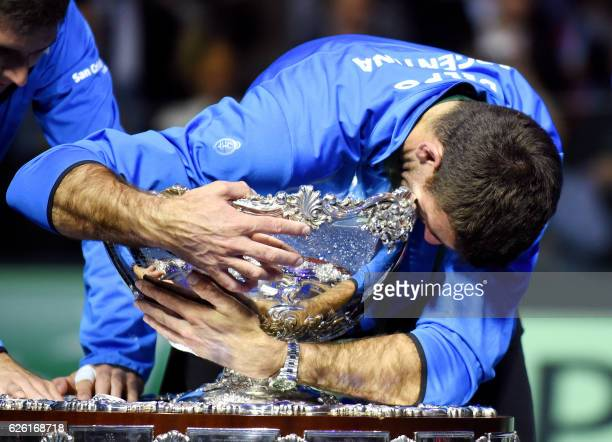 TOPSHOT Argentina's Juan martin del Potro hugs the trophy after winning the Davis Cup World Group final between Croatia and Argentina on November 27...
