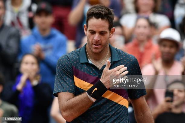 Argentina's Juan Martin del Potro makes the sign of the cross as he celebrates after winning against Japan's Yoshihito Nishioka during their men's...