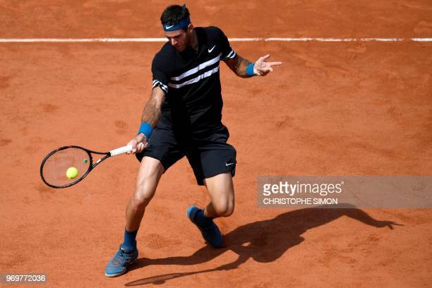TOPSHOT Argentina's Juan Martin del Potro plays a forehand return to Spain's Rafael Nadal during their men's singles semifinal match on day thirteen...