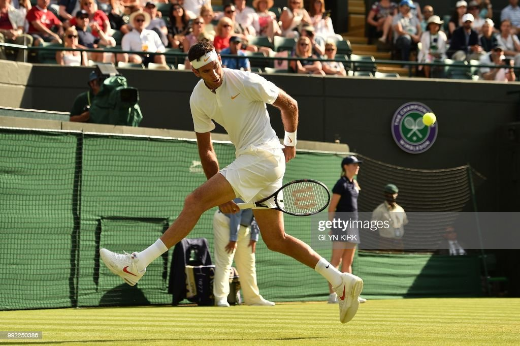 TOPSHOT - Argentina's Juan Martin del Potro plays a return shot through his legs against Spain's Feliciano Lopez during their men's singles second round match on the fourth day of the 2018 Wimbledon Championships at The All England Lawn Tennis Club in Wimbledon, southwest London, on July 5, 2018. (Photo by Glyn KIRK / AFP) / RESTRICTED