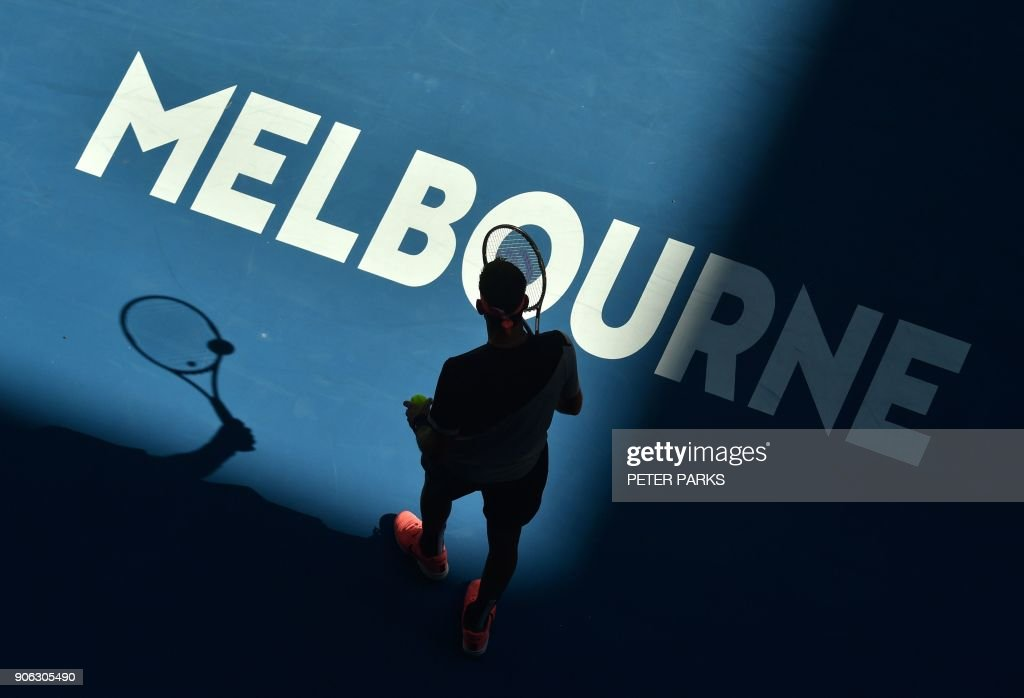 TOPSHOT - Argentina's Juan Martin del Potro prepares to serve to Russia's Karen Khachanov in their men's singles second round match on day four of the Australian Open tennis tournament in Melbourne on January 18, 2018. /