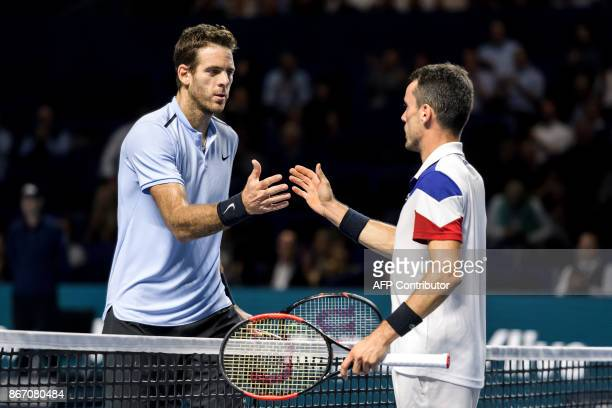 Argentina's Juan Martin Del Potro r shakes hands twith Spain's Roberto Bautista Agut after winning the quarterfinal game at the Swiss Indoors ATP 500...