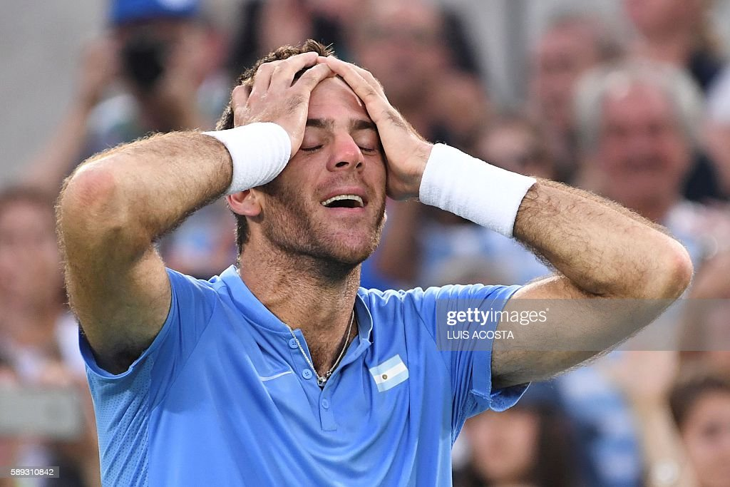 TOPSHOT - Argentina's Juan Martin Del Potro reacts after winning his men's singles semi-final tennis match against Spain's Rafael Nadal at the Olympic Tennis Centre of the Rio 2016 Olympic Games in Rio de Janeiro on August 13, 2016. / AFP / Luis Acosta