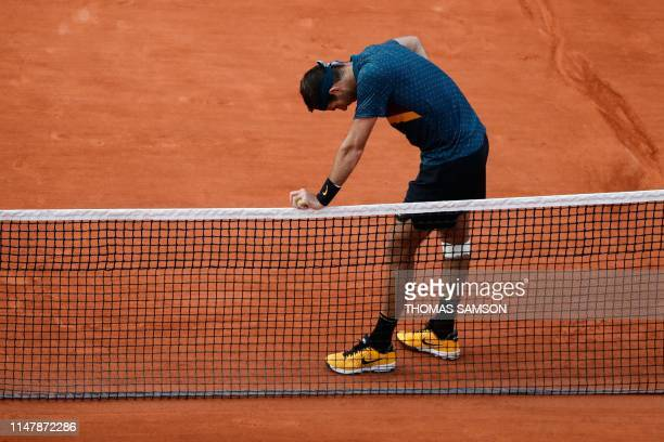 TOPSHOT Argentina's Juan Martin del Potro reacts during his men's singles fourth round match against Russia's Karen Khachanov on day nine of The...
