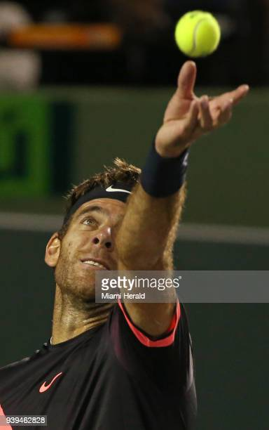 Argentina's Juan Martin del Potro returns a shot against Milos Raonic of Canada during the quarterfinals of the Miami Open on Wednesday March 28 at...