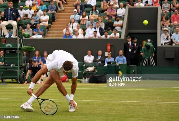 Argentina's Juan Martin del Potro returns against France's Gilles Simon during their men's singles fourth round match on the seventh day of the 2018...