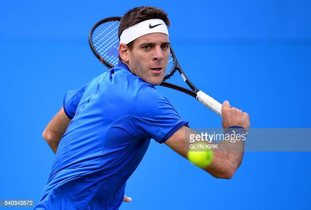 Argentina's Juan Martin Del Potro returns against US player John Isner during their match at the ATP Aegon Championships tennis tournament at the...