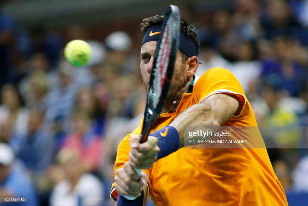 Argentina's Juan Martin del Potro returns the ball to Croatia's Borna Coric during their men's singles tennis match on Day 7 of the 2018 US Open at the USTA Billie Jean King National Tennis Center on September 2, 2018 in New York City.
