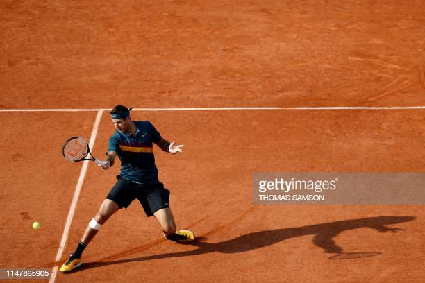 Argentina's Juan Martin del Potro returns the ball to Russia's Karen Khachanov during their men's singles fourth round match on day nine of The...