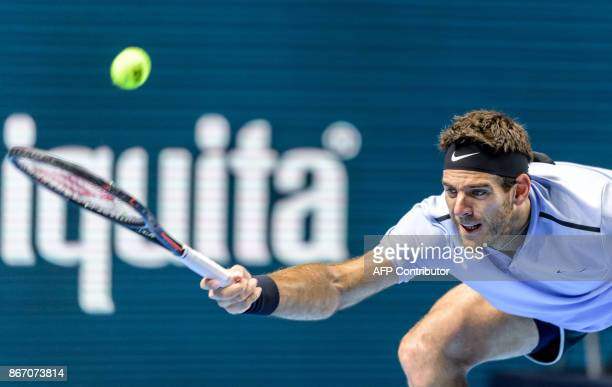 Argentina's Juan Martin Del Potro returns the ball to Spain's Roberto Bautista Agut during their quarterfinal game at the Swiss Indoors ATP 500...