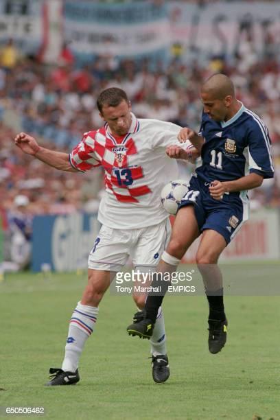 Argentina's Juan Veron and Croatia's Mario Stanic battle for the ball