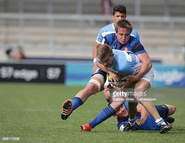 Argentina's Julian Dominguez is tackled by France's Anthony Jelonch during the 2016 U20 World Rugby Championships Pool C Match 1 between France U20...