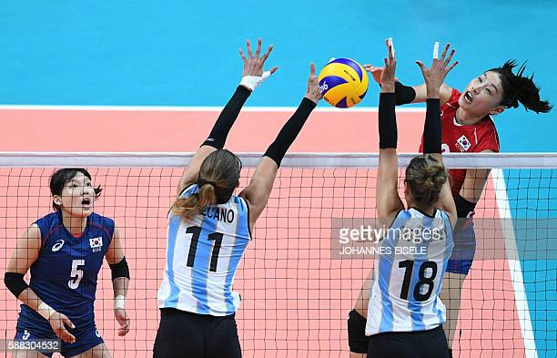 Argentina's Julieta Lazcano Colodrero and Yael Castiglione jumps to block the ball during the women's qualifying volleyball match between South Korea...