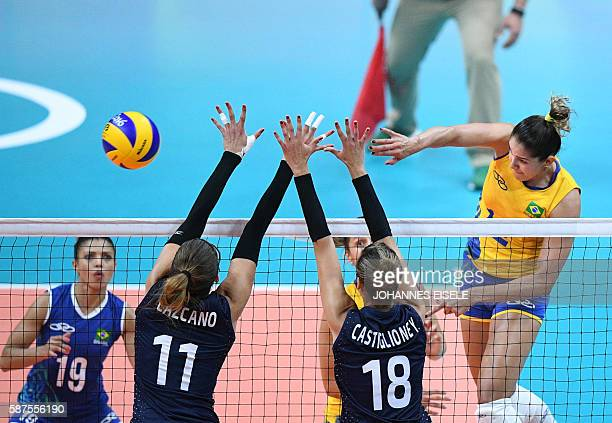 Argentina's Julieta Lazcano Colodrero and Yael Castiglione try to block the ball during the women's qualifying volleyball match between Brazil and...