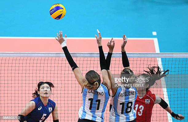 Argentina's Julieta Lazcano Colodrero and Yael Castiglione try to block the ball during the women's qualifying volleyball match between South Korea...