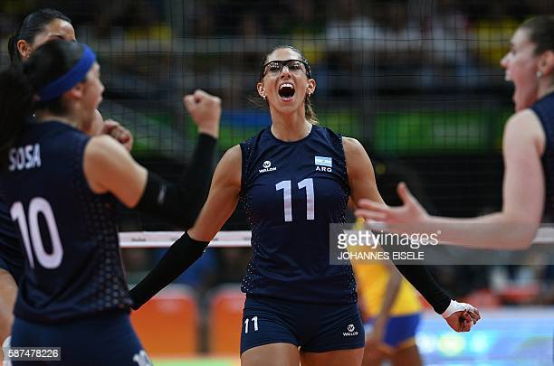Argentina's Julieta Lazcano Colodrero celebrates after winning a point during the women's qualifying volleyball match between Brazil and Argentina at...