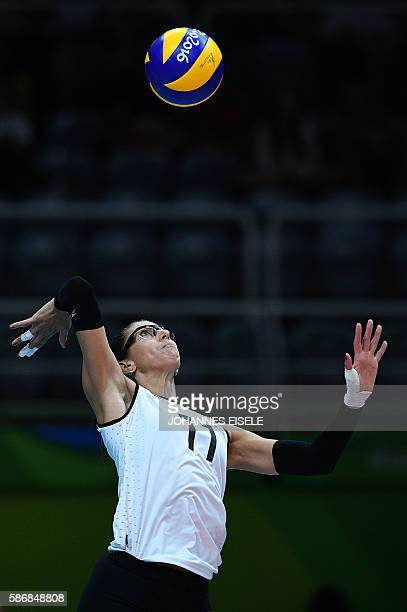 Argentina's Julieta Lazcano Colodrero serves during the women's qualifying volleyball match between Russia and Argentina at the Maracanazinho stadium...