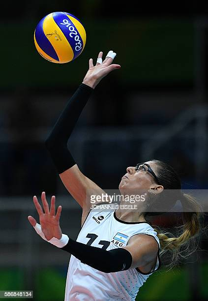 Argentina's Julieta Lazcano Colodrero serves the ball during the women's qualifying volleyball match between Russia and Argentina at the...