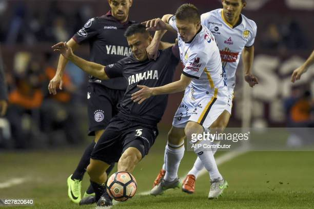 Argentina's Lanus defender Maximiliano Velazquez vies for the ball with Bolivia's The Strongest midfielder Alejandro Saul Chumacero during their Copa...