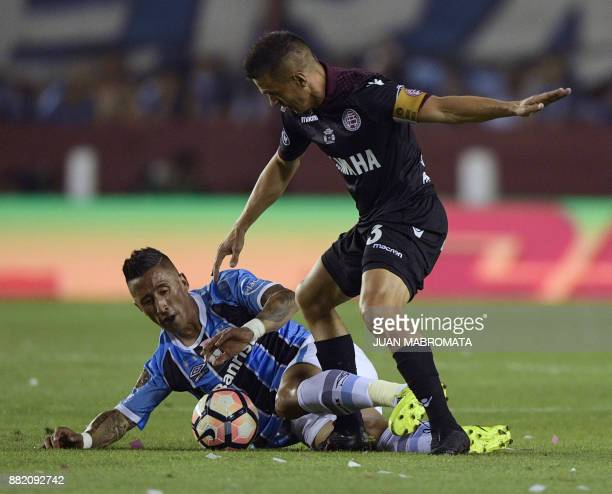 Argentina's Lanus defender Maximiliano Velazquez vies for the ball with Brazil's Gremio forward Lucas Barrios during their Copa Libertadores 2017...
