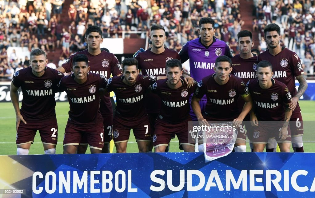 Argentina's Lanus football team pose during the Copa Sudamericana 2018 first stage football match against Peru's Sporting Cristal at 'La Fortaleza' stadium in Lanus, Buenos Aires, Argentina, on February 21, 2018. /