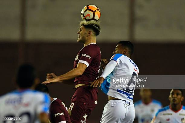 Argentina's Lanus forward Fernando Coniglio vies for the ball with Colombia's Junior midfielder James Sanchez during the Copa Sudamericana football...