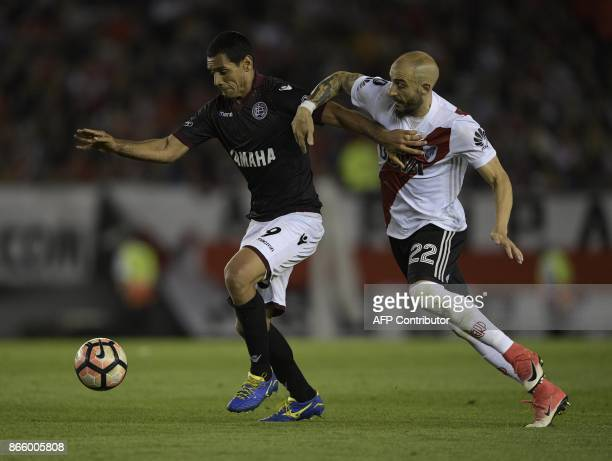 Argentina's Lanus forward Jose Sand vies for the ball with Argentina's River Plate defender Javier Pinola during the 2017 Copa Libertadores semifinal...