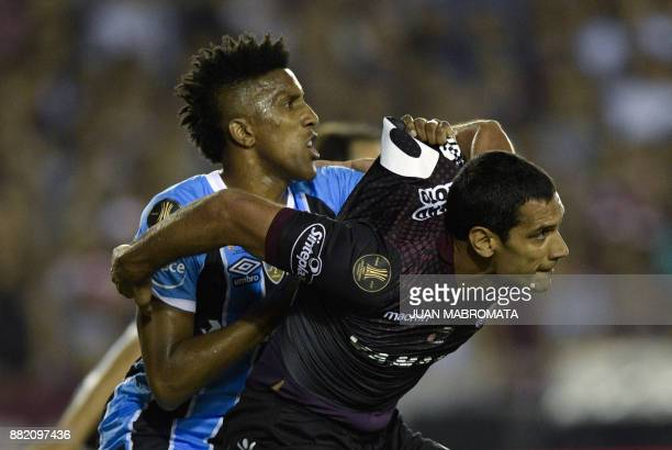 Argentina's Lanus forward Jose Sand vies for the ball with Brazil's Gremio defender Bruno Cortez during their Copa Libertadores 2017 final football...