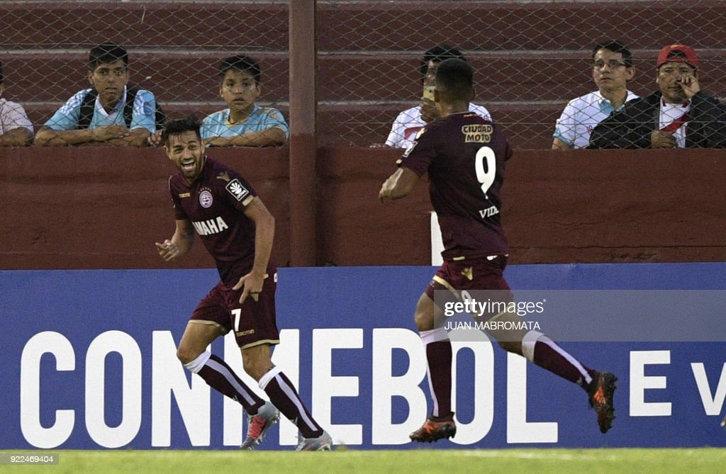Argentina's Lanus forward Lautaro Acosta (L) celebrates next to teammate forward Bruno Vides after scoring the team's second goal against Peru's Sporting Cristal during theirCopa Sudamericana 2018 first stage football match at 'La Fortaleza' stadium in Lanus, Buenos Aires, Argentina, on February 21, 2018. /