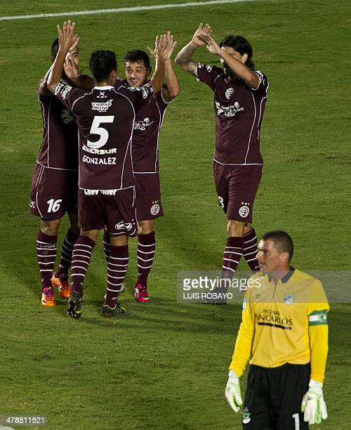 Argentina's Lanus forward Lautaro Acosta celebrates with teammates after scoring a goal against Deportivo Cali of Colombia during their Libertadores...