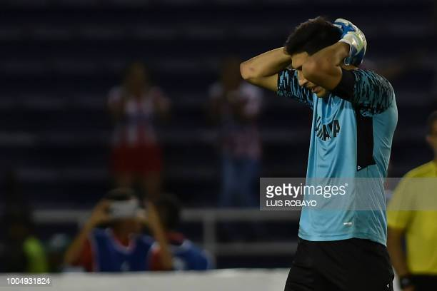 Argentina's Lanus goalkeeper Esteban Andrada reacts after the miss of a penalty shot over Colombia's Junior during their Copa Sudamericana football...