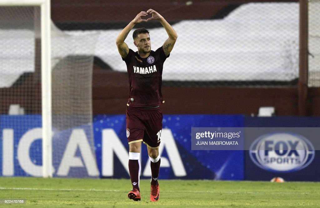 Argentina's Lanus midfielder Alejandro Silva celebrates after scoring a penalty shot, the team's third goal against Peru's Sporting Cristal during the Copa Sudamericana 2018 first stage football ma...