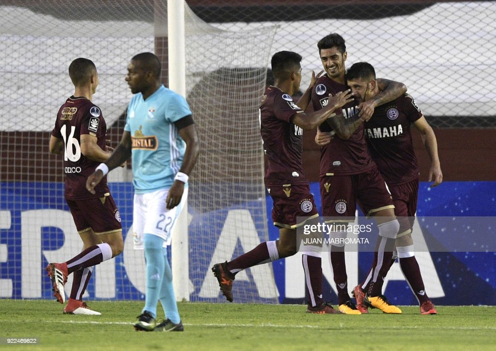 Argentina's Lanus midfielder Alejandro Silva (R) celebrates with teammates after scoring a penalty shot, the team's third goal against Peru's Sporting Cristal during their Copa Sudamericana 2018 first stage football match at 'La Fortaleza' stadium in Lanus, Buenos Aires, Argentina, on February 21, 2018. /