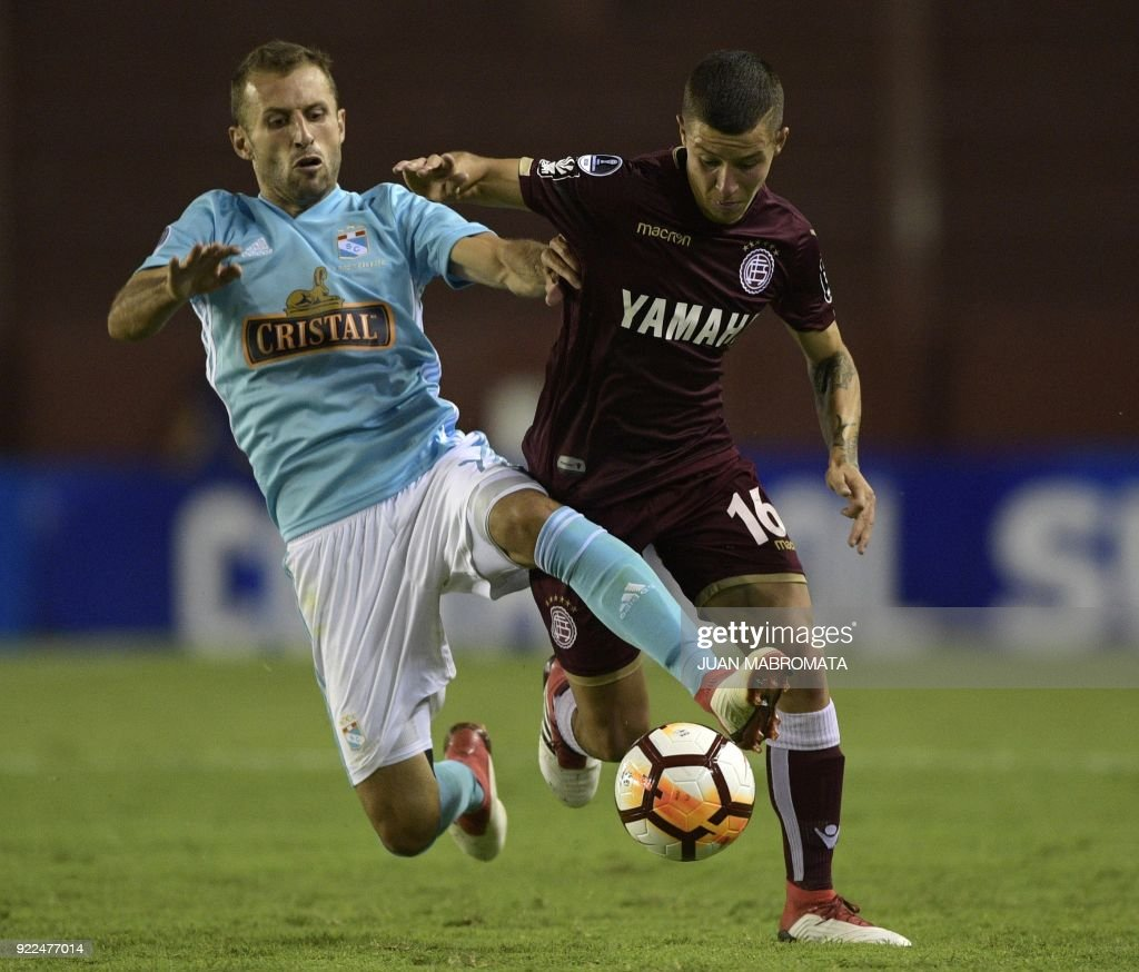 Argentina's Lanus midfielder Gaston Lodico (R) vies for the ball with Peru's Sporting Cristal midfielder Horacio Calcaterra during their Copa Sudamericana 2018 first stage football match at 'La For...