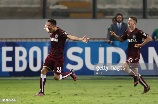 Argentina's Lanus Rolando Garcia celebrates after scoring a goal against Peru's Sporting Cristal during their Copa Sudamericana football match at the...