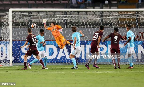 Argentina's Lanus Rolando Garcia scores a goal against Peru's Sporting Cristal during their Copa Sudamericana football match at the National stadium...