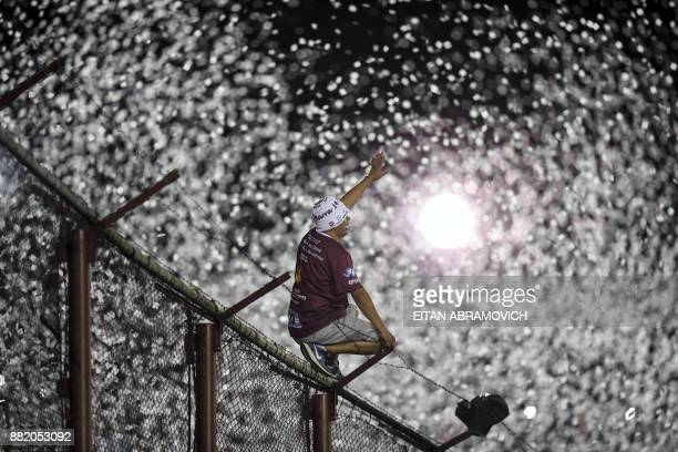 Argentina's Lanus supporters cheer for their team during the Copa Libertadores 2017 final football match against Brazil's Gremio at Lanus stadium in...