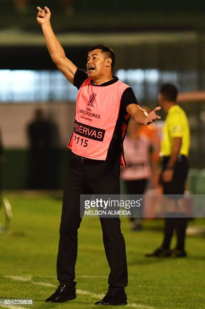 Argentina's Lanus team coach Jorge Francisco Almiron gestures during the Libertadores Cup football match against Brazil's Chapecoense held at Arena...