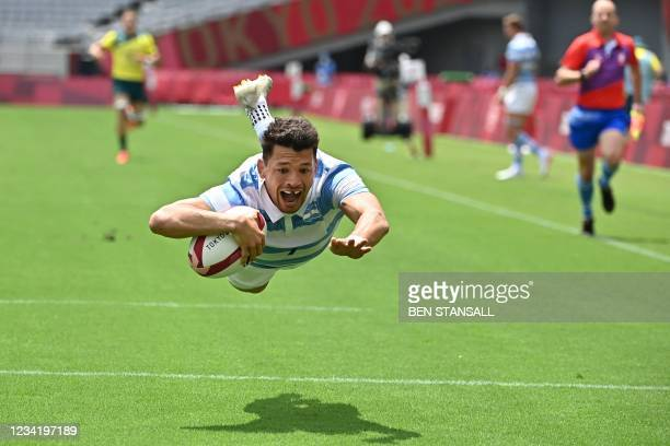 Argentina's Lautaro Bazan Velez scores a try in the men's pool A rugby sevens match between Australia and Argentina during the Tokyo 2020 Olympic...