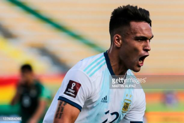 Argentina's Lautaro Martinez celebrates after scoring against Bolivia during their 2022 FIFA World Cup South American qualifier football match at the...