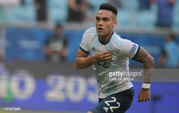 Argentina's Lautaro Martinez celebrates after scoring against Qatar during their Copa America football tournament group match at the Gremio Arena in...
